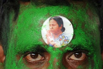 (FILES) In this photograph taken on June 2, 2012, a sticker bearing a portrait of Trinamool Congress (TMC) Leader Mamata Banerjee is seen on the forehead of a supporter outside a counting centre in Kolkata.  India's government was left reeling on September 19, 2012,  after a key ally announced it would quit the ruling coalition as part of a growing push to derail a controversial economic reform drive.  The regional Trinamool party said late September 18, that it had decided to withdraw support from the Congress-led coalition in a move analysts said heightened the prospects of early elections, not currently due until 2014.   AFP PHOTO/Deshakalyan CHOWDHURY/FILES